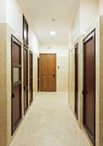 Modern hall interior with many doors. Modern hall interior with many hardwood doors Royalty Free Stock Photography
