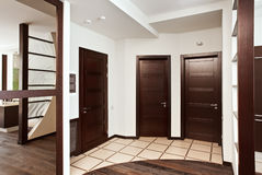 Modern hall interior with many hardwood doors Stock Images
