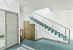 Modern hall with metal staircase Royalty Free Stock Images