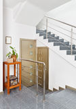 Modern hall with metal staircase interior Royalty Free Stock Photography