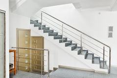 Modern hall with metal staircase interior. In minimalism style Stock Photos