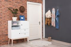 Modern hallway interior with stylish cabinet and clothes stock photos