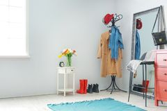 Modern Hallway Interior With Clothes On Hanger Stand And Mirror Stock Image