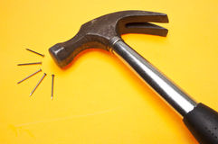 Modern Hammer and Nails Stock Images