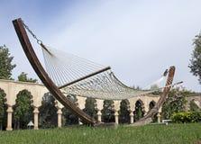 Modern hammock. In a luxurious garden Royalty Free Stock Photography