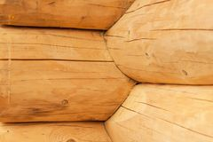 Modern Hand Hewn Natural Log Cabin Wall Facade Frame Texture. Rustic Log Wall Square Timber Background. Modern Hand Hewn Natural Log Cabin Wall Facade Frame Stock Image