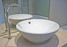 Modern hand wash basin. Modern bowl shape ceramic hand wash basin with designer water tap Stock Photos