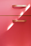Modern handle on pink furniture Stock Image