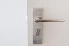 Modern Handle steel knob on the door Stock Images