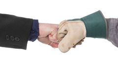 Modern handshake. Two fists meet in front of the camera Stock Image