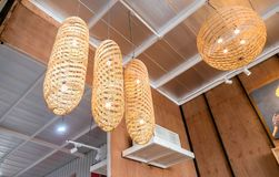 Modern hanging wooden lamp on the ceiling Royalty Free Stock Image