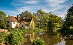 The modern Hay Wain. A contemporary view of Flatford Mill, the scene painted by John Constable in his painting `The Hay Wain` in the Dedham Vale district of East Stock Photo