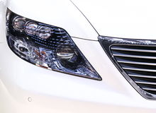 Modern headligts of white car. Modern design of front headligts,close up view stock image
