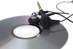 Modern headphones and CD Royalty Free Stock Photo