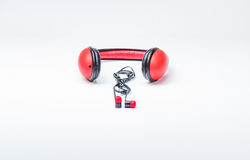 Modern headphones and earphones. Red wired wireless head sets on white background royalty free stock photography