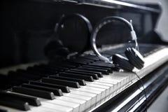Modern headphones on keys. Modern headphones on piano keys Royalty Free Stock Images