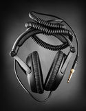 Modern headphones over dark background Stock Images