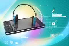 Modern headphones and smart phone Stock Images