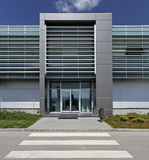 Modern headquarters. Aluminium building with glass entrance Royalty Free Stock Photos