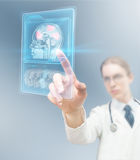 Modern healthcare. Doctor analyzing brain activity on futuristic screen Royalty Free Stock Photography