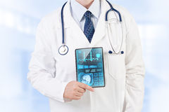 Modern healthcare. Doctor with medical analysis on tablet stock images