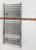 Modern Heated towel rail. Chrome heated towel rail which serves a dual purpose as a radiator and towel dryer in modern bathrooms stock photos