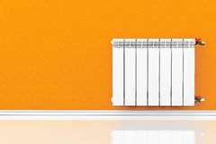 Modern Heating Radiator with orange wall Royalty Free Stock Images