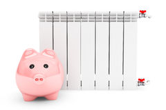Modern Heating Radiator with Piggy Bank Stock Photo