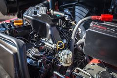Modern hi-tech engine or motor of industrial loader or combine vehicle or small tractor. Close up Royalty Free Stock Images
