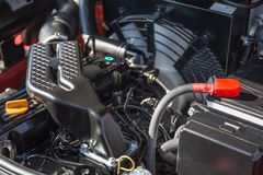 Modern hi-tech engine or motor of industrial loader or combine vehicle or small tractor. Close up Stock Photo