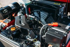 Modern hi-tech engine or motor of industrial loader or combine vehicle. Or small tractor Royalty Free Stock Images