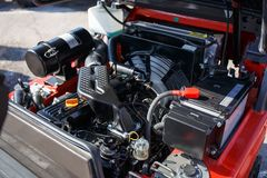 Modern hi-tech engine or motor of industrial loader or combine vehicle or small tractor. Close up Stock Images
