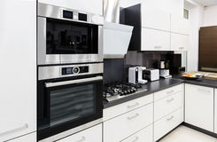 Modern hi-tek kitchen, clean interior design Royalty Free Stock Photos