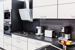 Modern hi-tek kitchen, clean interior design Stock Image