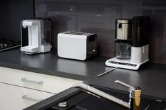 Modern hi-tek kitchen, clean interior design Stock Images
