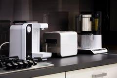 Modern hi-tek kitchen, clean interior design Royalty Free Stock Photos