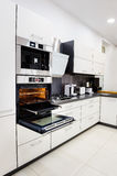 Modern hi-tek kitchen, oven with door open Stock Image