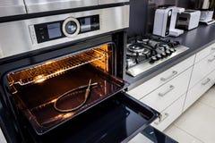 Modern hi-tek kitchen, oven with door open Royalty Free Stock Photography