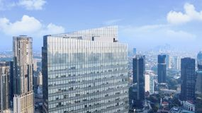 Modern high buildings at sunny day. JAKARTA - Indonesia. May 21, 2018: Aerial view of modern high buildings at sunny day in Jakarta Central Business District Royalty Free Stock Photos