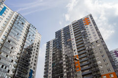 Modern high-rise apartment buildings on a sunny day. Modern high-rise apartment buildings on a bright sunny day Royalty Free Stock Photos