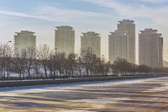 Modern high rise block of flats. Picturesque morning scenery with modern high rise block of flats near frozen Dambovita river, in south-eastern Bucharest Royalty Free Stock Photo