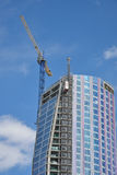 Modern High Rise Building. With crane Stock Photo