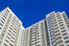 Modern high rise building. A modern high rise building with balconies Royalty Free Stock Photos