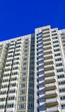 Modern high rise building. A modern high rise building with balconies Stock Photos