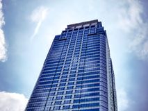 Modern High Rise Building Against Blue Sky. Low Angle View of Modern High Rise Building Against Blue Sky Royalty Free Stock Image