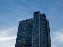 Modern high rise building at dusk stock photo
