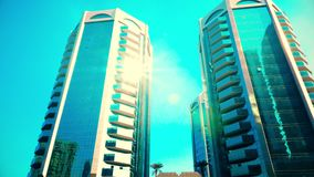 Modern high rise buildings business center in United Arab Emirates. Reflection sunlight in glass facades modern skyscrapers in modern Sharjah City in United Arab stock video