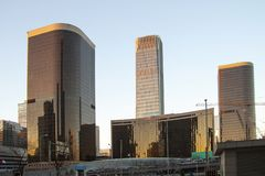 Modern high rise buildings. Skyline image with reflections in windows. Stock image stock images