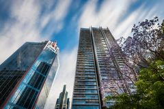 Modern High-rise Buildings in Sydney City Center. SYDNEY, NSW, AUSTRALIA - November 2, 2017: Looking up perspective of the new Lumiere high-rise Residences Royalty Free Stock Photo