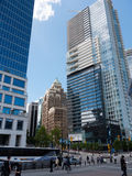 Modern high rises in downtown Vancouver. Modern high-rises in downtown Vancouver, with new glass and steel contrasting the older brick based building style Royalty Free Stock Image